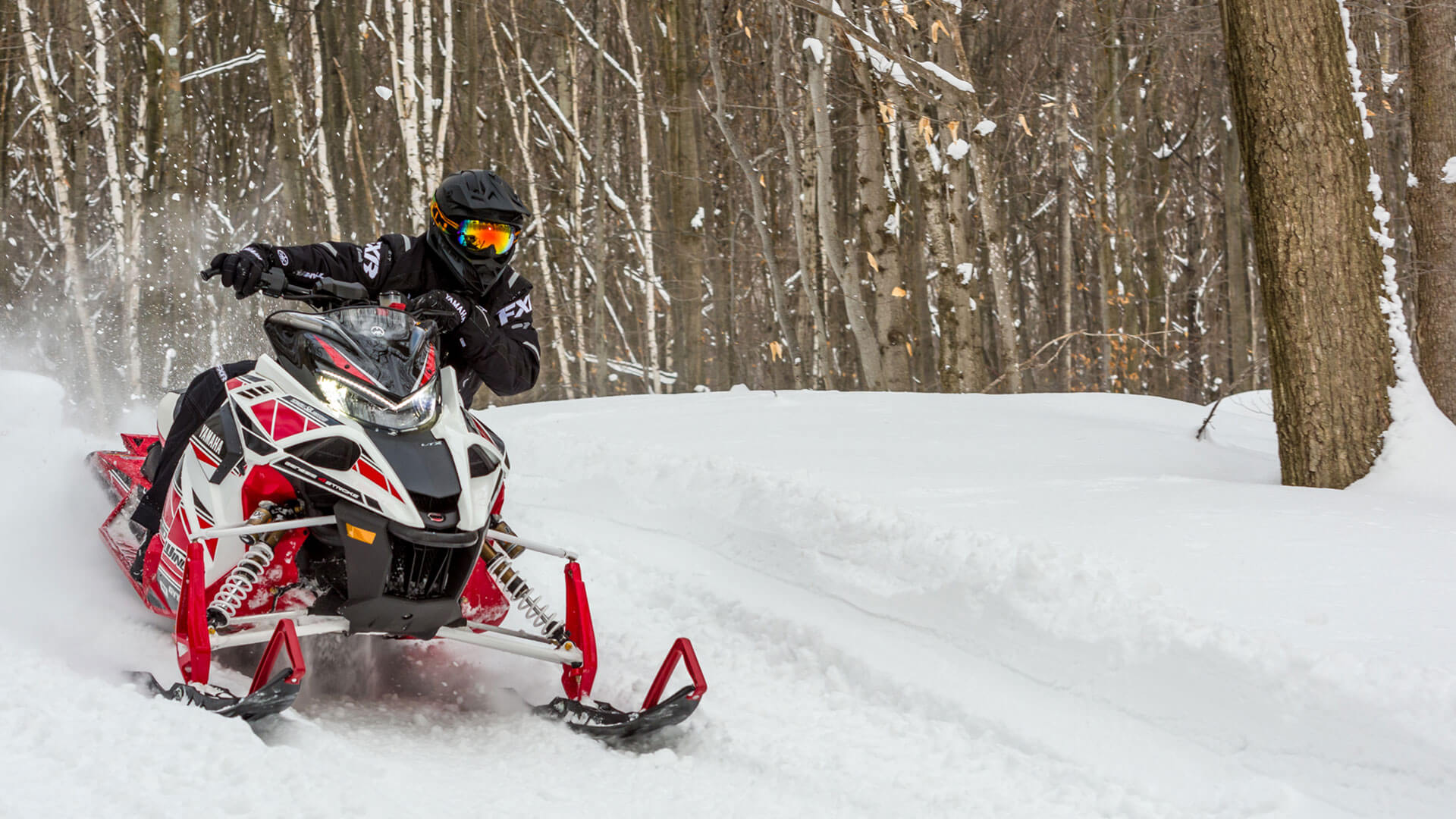 A snowmobile image, one of a series of rotating background images